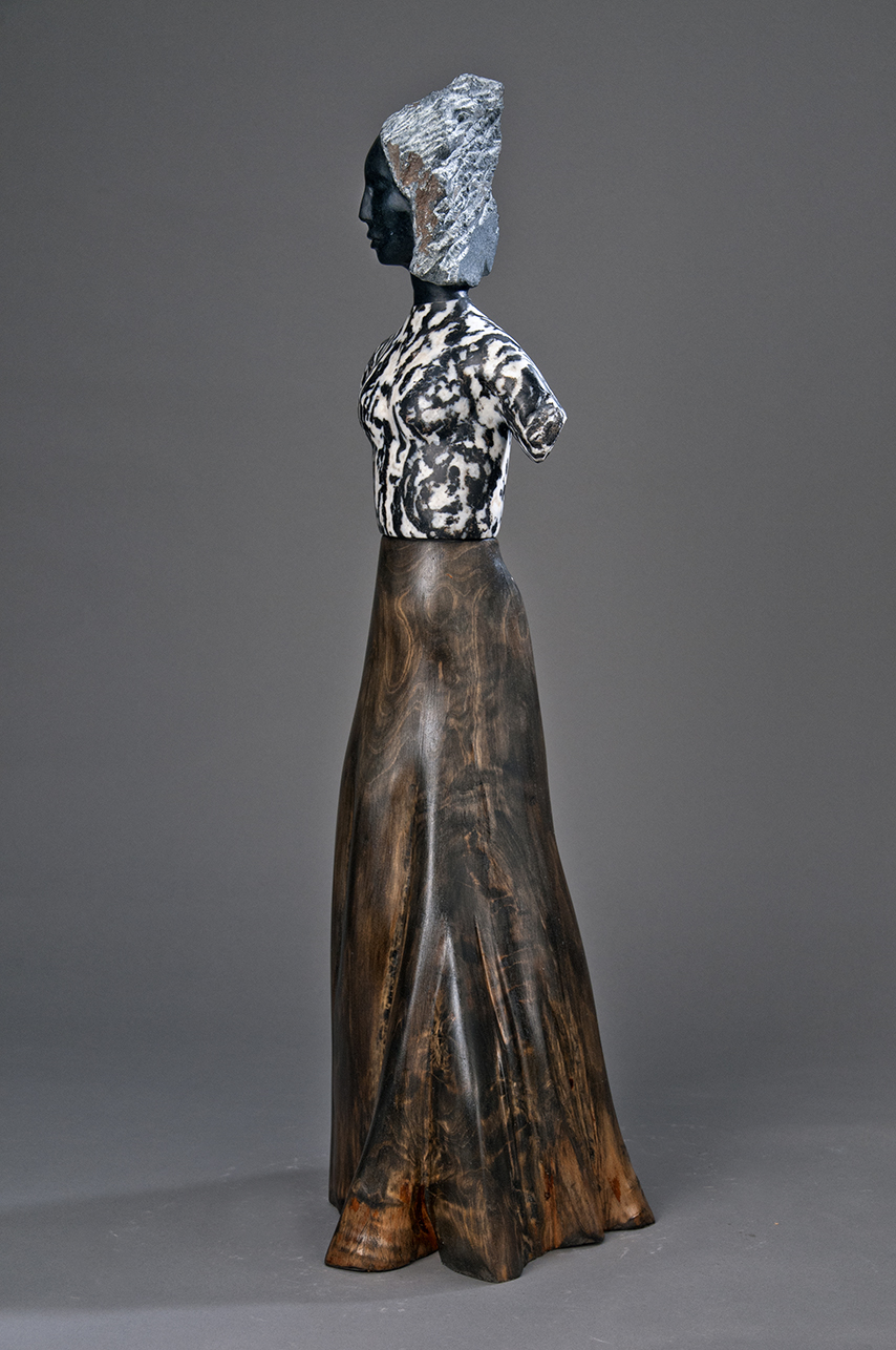 stone and cypress figurative sculpture